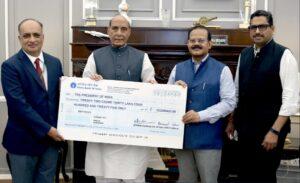 Raksha-Mantri-Shri-Rajnath-Singh-receiving-a-dividend-cheque-from-Cmde-B-B-Nagpal-Retd-CMD-GSL-in-New-Delhi.-Secretary-Defence-Production-Shri-Raj-Kumar-IAS-and-Additional-Secretary-Shri-Sanjay-Jaju-